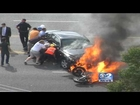 Amazing rescue: Bystanders lift burning car off injured motorcyclist...