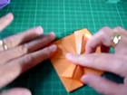Origami flower, nice as gift wrapping embellishment !